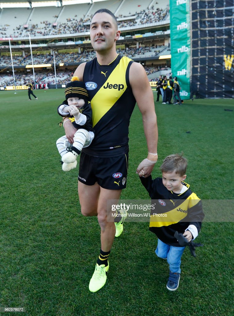 Shaun Grigg of the Tigers runs through the banner with his children for his 200th match during the 2018 AFL round 10 match between the Richmond Tigers and the St Kilda Saints at the Melbourne Cricket Ground on May 26, 2018 in Melbourne, Australia.