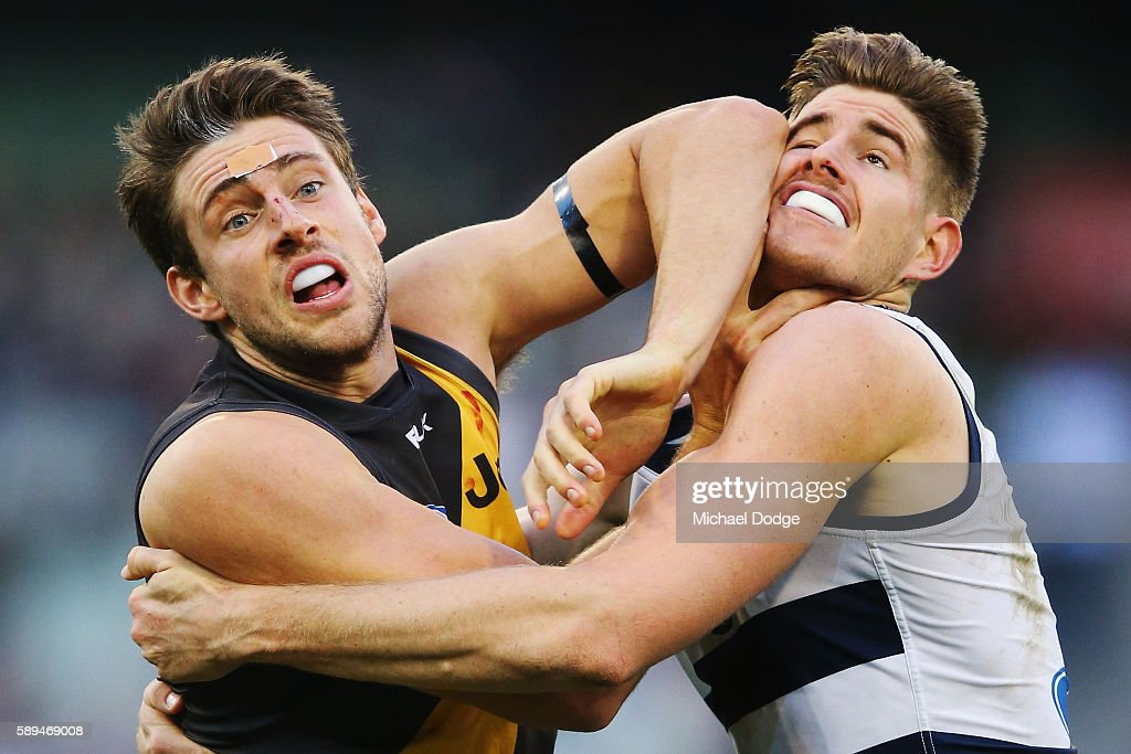 Shaun Hampson of the Tigers elbows Zac Smith of the Cats to the head when competing for the ball during the round 21 AFL match between the Richmond Tigers and the Geelong Cats at Melbourne Cricket Ground on August 14, 2016 in Melbourne, Australia.