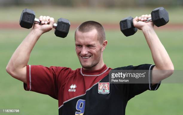 Shaun Harrad of Northampton Town lifts weights during a training session at Sixfields Stadium on July 4, 2011 in Northampton, England.