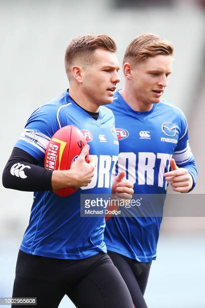 Shaun Higgins and Jack Ziebell of the Kangaroos warm up during the round 18 AFL match between the Collingwood Magpies and the North Melbourne...