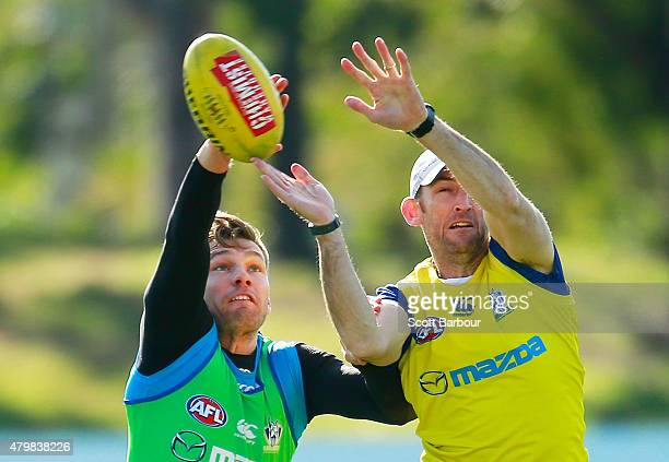 Shaun Higgins and Shane Watson Kangaroos ForwardLine Coach compete for the ball during a North Melbourne Kangaroos AFL training session at Arden...