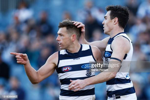 Shaun Higgins of the Cats celebrates with Jeremy Cameron of the Cats after kicking a goal during the round 10 AFL match between the Geelong Cats and...