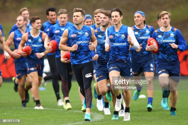 Shaun Higgins of the Kangaroos and Ben Jacobs warm up during the North Melbourne Kangaroos AFL training session at Arden Street Ground on May 24 2018...