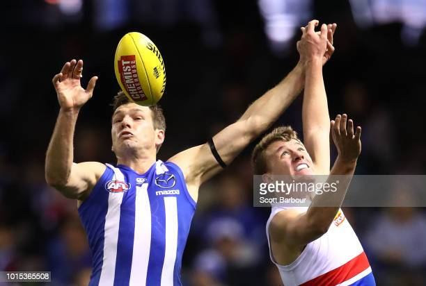 Shaun Higgins of the Kangaroos and Jack Macrae of the Bulldogs compete for the ball during the round 21 AFL match between the North Melbourne...