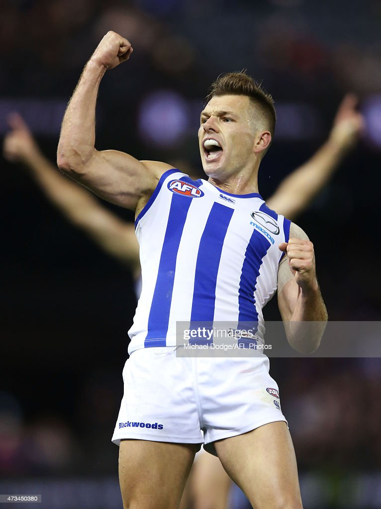 Shaun Higgins of the Kangaroos celebrates a match winning goal during the round seven AFL match between the Essendon Bombers and the North Melbourne Kangaroos at Etihad Stadium on May 15, 2015 in Melbourne, Australia.