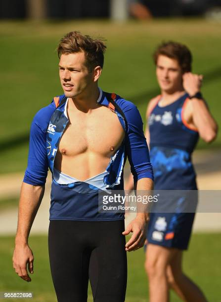 Shaun Higgins of the Kangaroos has his shirt ripped during a North Melbourne Kangaroos AFL training session at Catani Gardens on May 8 2018 in...