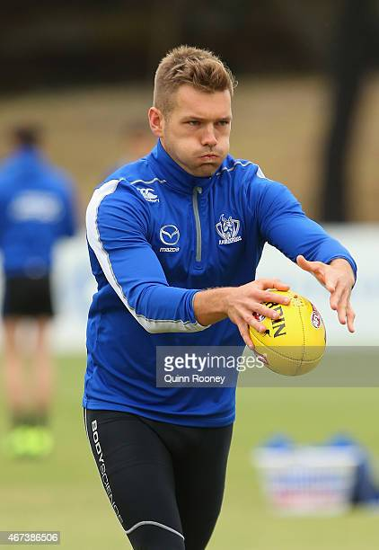 Shaun Higgins of the Kangaroos kicks during a North Melbourne Kangaroos AFL training session at Arden Street Oval on March 24 2015 in Melbourne...