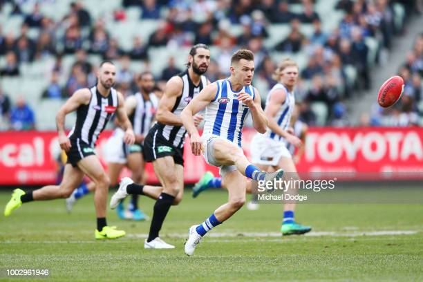 Shaun Higgins of the Kangaroos kicks the ball during the round 18 AFL match between the Collingwood Magpies and the North Melbourne Kangaroos at...