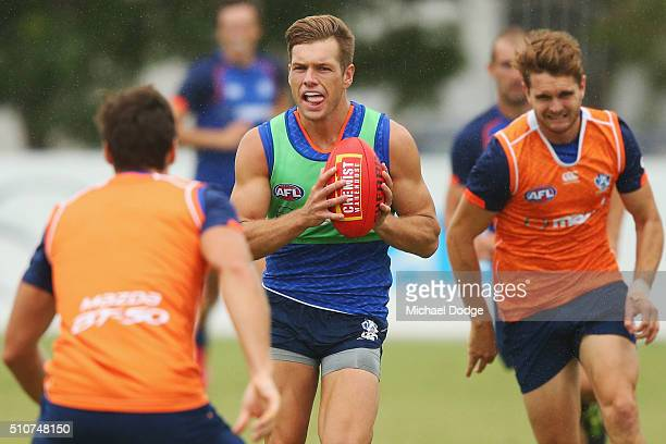 Shaun Higgins of the Kangaroos runs with the ball during a North Melbourne Kangaroos AFL media session at Arden Street Ground on February 17 2016 in...