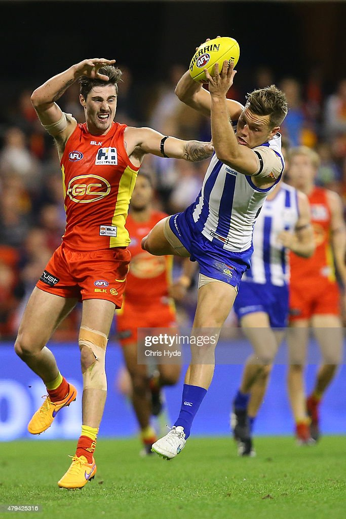 Shaun Higgins of the Kangaroos takes a mark during the round 14 AFL match between the Gold Coast Suns and the North Melbourne Kangaroos at Metricon Stadium on July 4, 2015 in Gold Coast, Australia.