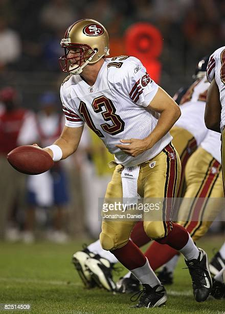 Shaun Hill of the San Francisco 49ers turns to hand off against the Chicago Bears on August 21 2008 at Soldier Field in Chicago Illinois The 49ers...