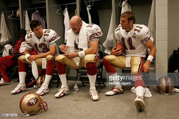 Shaun Hill Trent Dilfer and Alex Smith of the San Francisco 49ers prepare in the locker room before the season opening game against the Arizona...