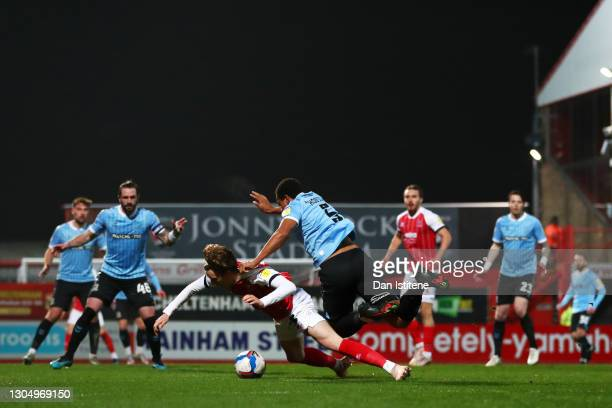 Shaun Hobson of Southend United fouls Callum Wright of Cheltenham Town and concedes a penalty during the Sky Bet League Two match between Cheltenham...