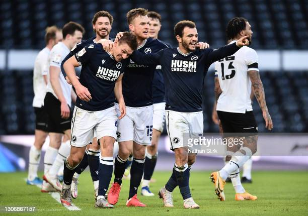Shaun Hutchinson of Millwall FC celebrates with teammates Alex Pearce and Mason Bennett after scoring their team's first goal during the Sky Bet...