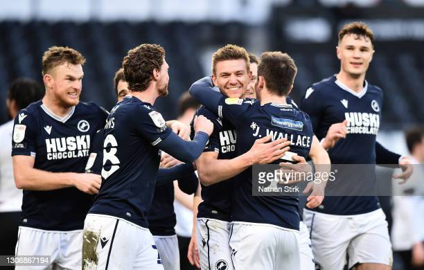 Shaun Hutchinson of Millwall FC celebrates with teammates George Evans and Jed Wallace after scoring their team's first goal during the Sky Bet...