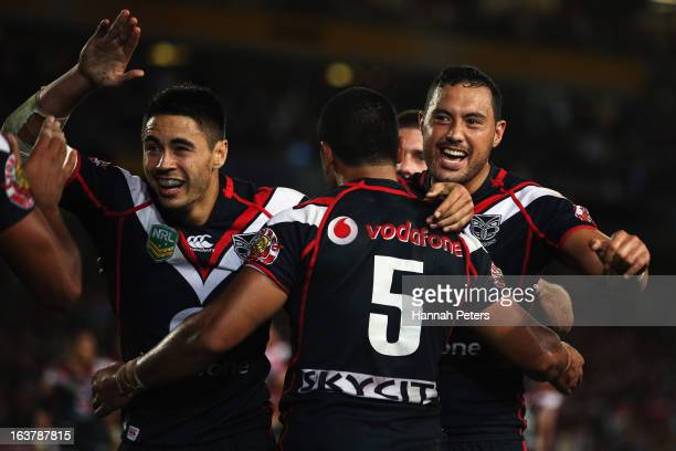 Shaun Johnson and Feleti Mateo of the Warriors celebrate with Bill Tupou after his try during the round two NRL match between the New Zealand...