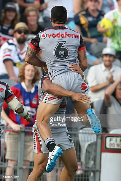 Shaun Johnson and Roger Tuivasa Sheck of the Warriors celebrate the winning try scored in Golden point extra time during the round five NRL match...