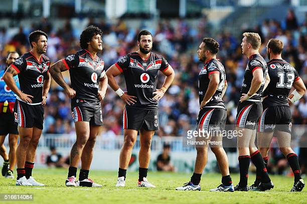 Shaun Johnson James Gavet and Ben Matulino of the Warriors look on after losing the round three NRL match between the New Zealand Warriors and the...
