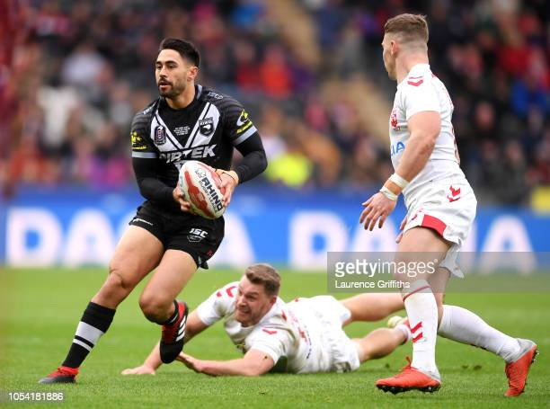 Shaun Johnson of New Zealand breaks away from the tackle of Elliott Whitehead of England during the International Series match between England and...