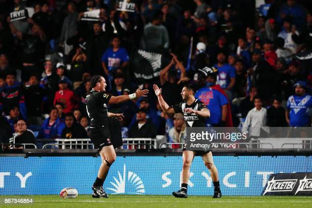 Shaun Johnson of the Kiwis celebrates with teammate Brad Takairangi after scoring a try during the 2017 Rugby League World Cup match between the New...