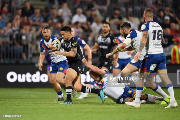 Shaun Johnson of the Kiwis charges forward during the Rugby League Test match between the New Zealand Kiwis and the Great Britain Rugby League Lions...