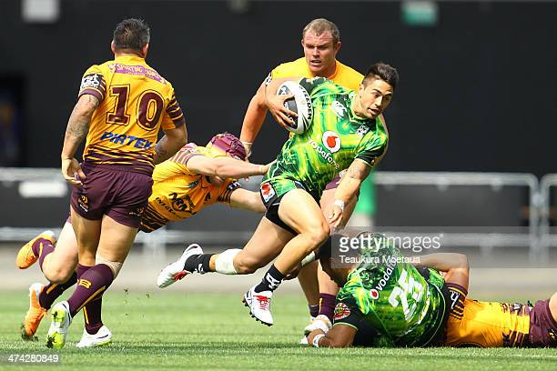 Shaun Johnson of the New Zealand Warriors makes a break during the NRL trial match between the Brisbane Broncos and the New Zealand Warriors at...