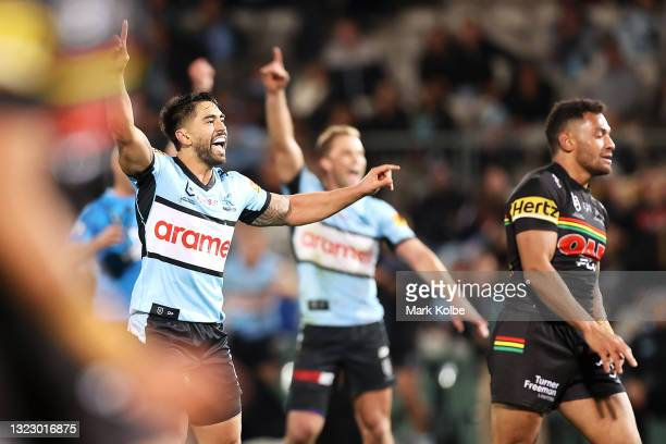 Shaun Johnson of the Sharks celebrates kicking a late field goal during the round 14 NRL match between the Cronulla Sharks and the Penrith Panthers...