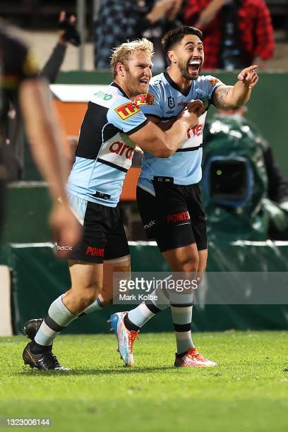 Shaun Johnson of the Sharks celebrates with his team mates after scoring a try during the round 14 NRL match between the Cronulla Sharks and the...