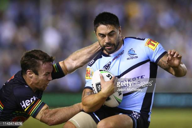 Shaun Johnson of the Sharks is tackled by James Maloney of the Panthers during the round 6 NRL rugby league match between the Sharks and the Panthers...