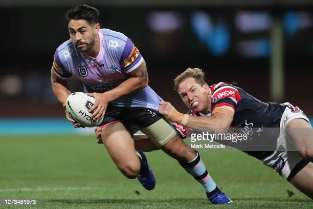 Shaun Johnson of the Sharks Is tackled by Mitchell Aubusson of the Roosters during the round 19 NRL match between the Sydney Roosters and the...