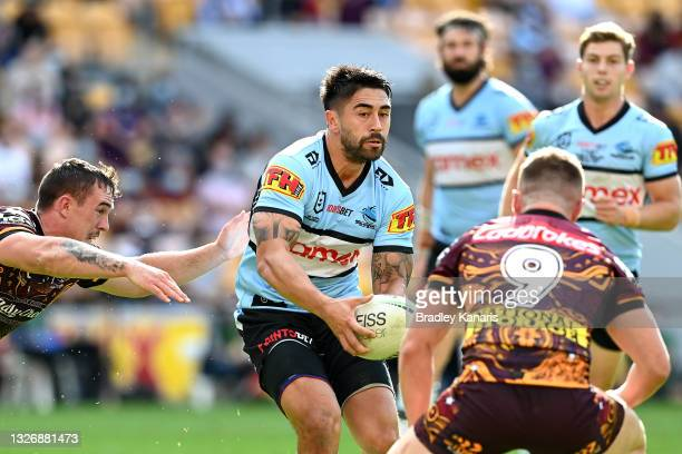Shaun Johnson of the Sharks looks to pass during the round 16 NRL match between the Brisbane Broncos and the Cronulla Sharks at Suncorp Stadium, on...