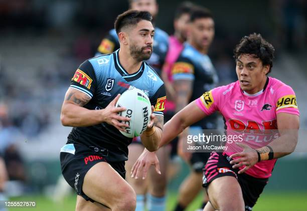 Shaun Johnson of the Sharks looks to pass the ball during the round nine NRL match between the Cronulla Sharks and the Penrith Panthers at Netstrata...