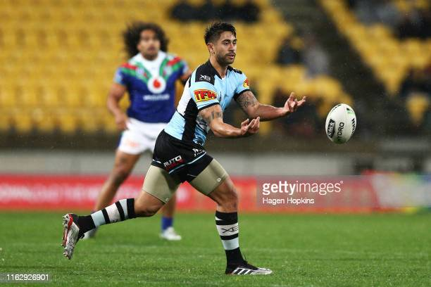 Shaun Johnson of the Sharks passes during the round 18 NRL match between the New Zealand Warriors and the Cronulla Sharks at Westpac Stadium on July...