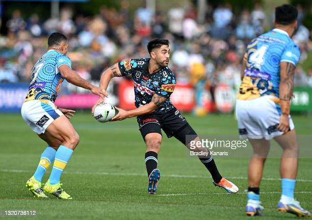 Shaun Johnson of the Sharks passes the ball during the round 12 NRL match between the Cronulla Sharks and the Gold Coast Titans at C.ex Coffs...