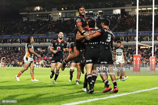 Shaun Johnson of the Warriors celebrates after scoring a try during the round nine NRL match between the New Zealand Warriors and the Wests Tigers at...
