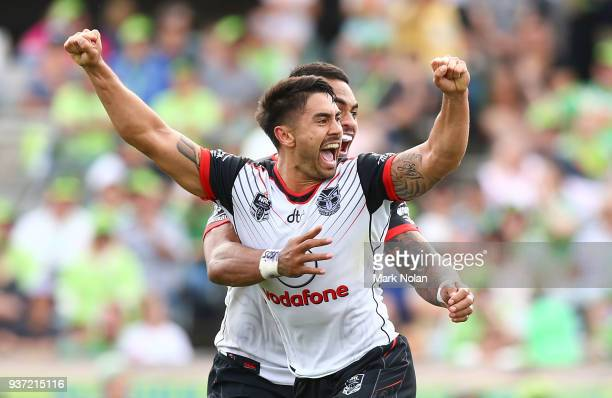 Shaun Johnson of the Warriors celebrates kicking a second field goal to win the round three NRL match between the Canberra Raiders and the New...