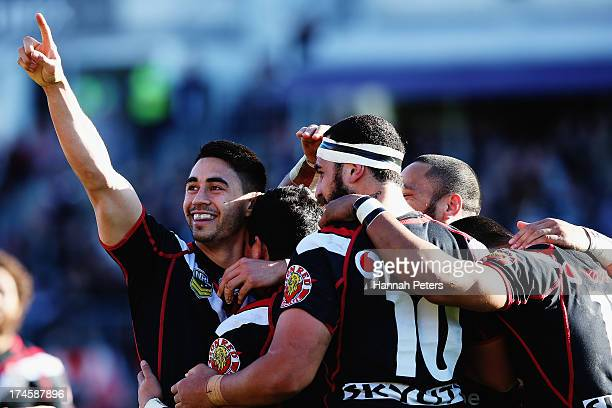 Shaun Johnson of the Warriors celebrates with Kevin Locke of the Warriors after his try to win the round 20 NRL match between the New Zealand...