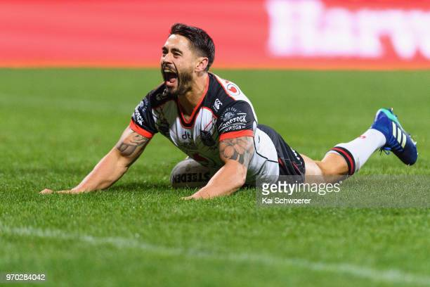 Shaun Johnson of the Warriors celebrtates scoring a try during the round 14 NRL match between the Manly Sea Eagles and the New Zealand Warriors at...