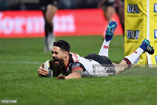 Shaun Johnson of the Warriors dives over to score a try during the round 14 NRL match between the Manly Sea Eagles and the New Zealand Warriors at...