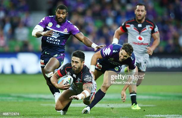 Shaun Johnson of the Warriors is tripped up by Billy Slater of the Storm stopping a definite try during the round five NRL match between the...