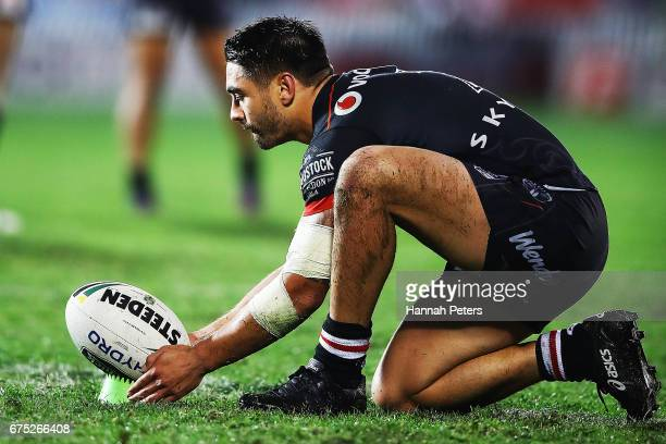Shaun Johnson of the Warriors lines up a penalty kick during the round nine NRL match between the New Zealand Warriors and the Sydney Roosters at Mt...