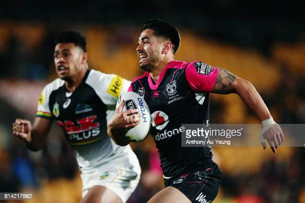 Shaun Johnson of the Warriors makes a break against Waqa Blake of the Panthers during the round 19 NRL match between the New Zealand Warriors and the...