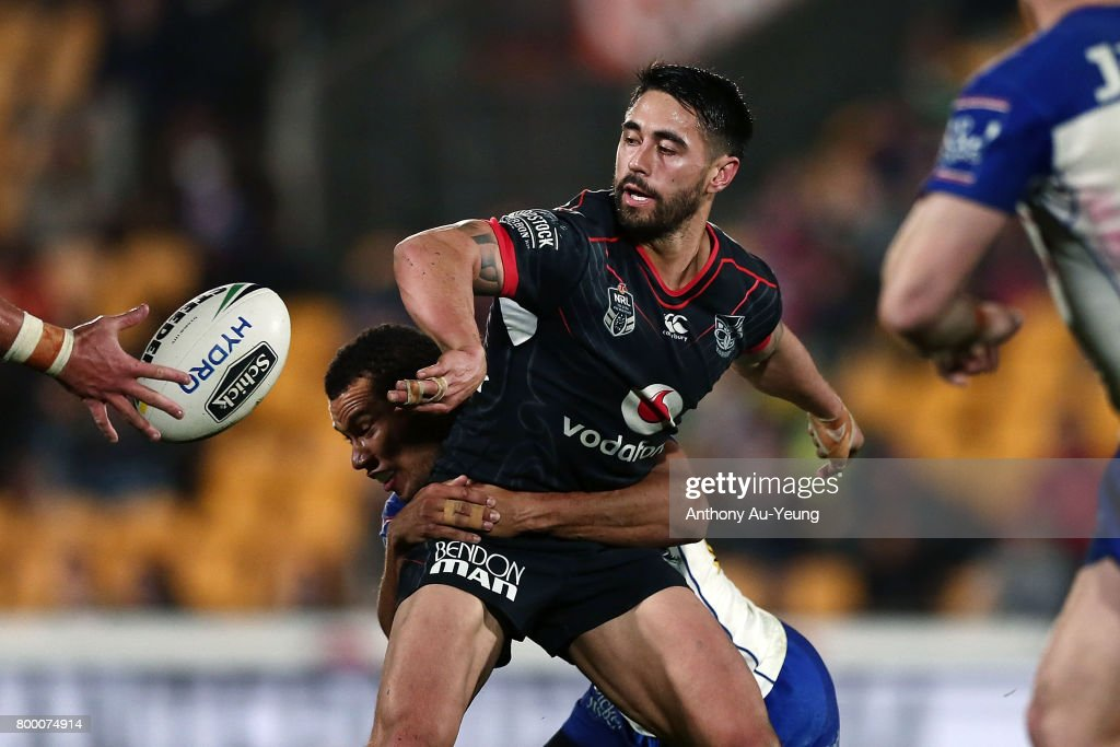 Shaun Johnson of the Warriors offloads in a tackle during the round 16 NRL match between the New Zealand Warriors and the Canterbury Bulldogs at Mt Smart Stadium on June 23, 2017 in Auckland, New Zealand.