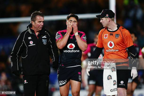 Shaun Johnson of the Warriors reacts after picking up an injury during the round 19 NRL match between the New Zealand Warriors and the Penrith...