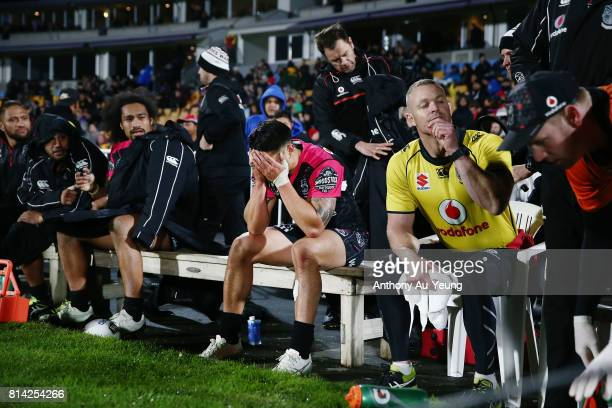 Shaun Johnson of the Warriors reacts on the bench after coming off with an injury during the round 19 NRL match between the New Zealand Warriors and...