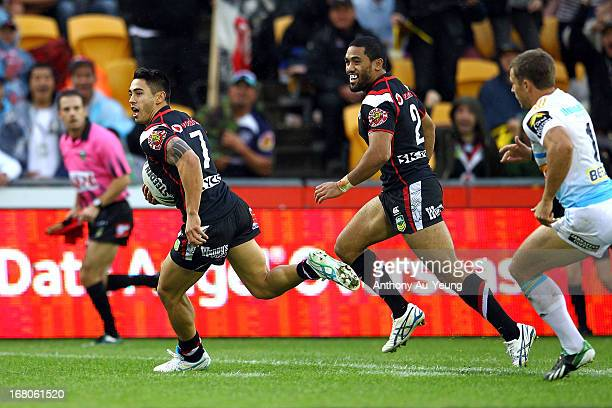 Shaun Johnson of the Warriors runs in a try during the round eight NRL match between the New Zealand Warriors and the Gold Coast Titans at Mt Smart...