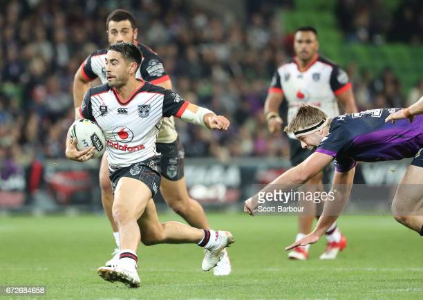 Shaun Johnson of the Warriors runs with the ball during the round eight NRL match between the Melbourne Storm and the New Zealand Warriors at AAMI...