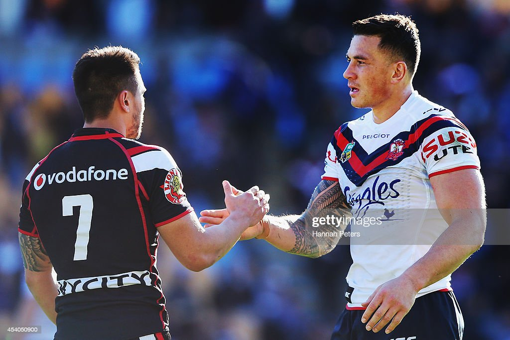 Shaun Johnson of the Warriors shakes hands with Sonny Bill Williams of the Roosters following the round 24 NRL match between the New Zealand Warriors and the Sydney Roosters at Mt Smart Stadium on August 24, 2014 in Auckland, New Zealand.