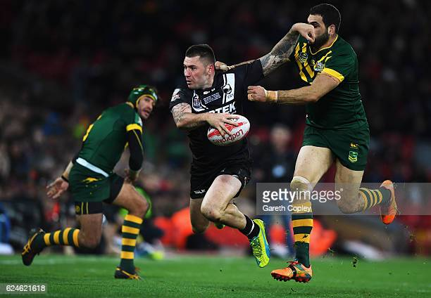 Shaun KennyDowall of New Zealand is tackled by Greg Inglis of Australia during the Four Nations Final between New Zealand and Australia at Anfield on...