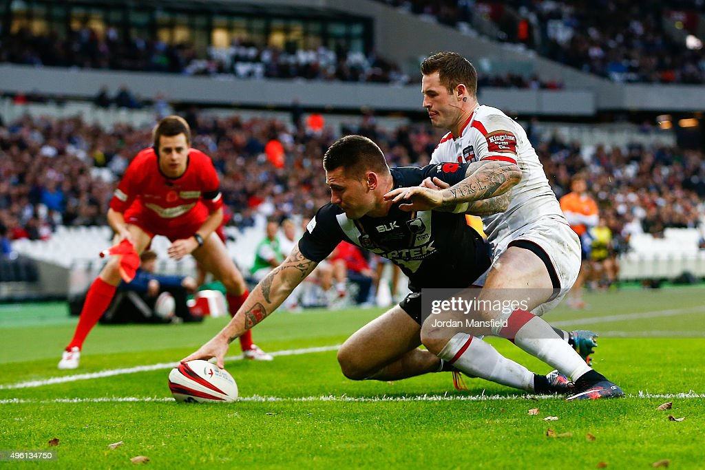 Shaun Kenny-Dowall of New Zealand touches down a try avoiding a tackle from Zak Hardaker of England during the International Rugby League Test Series match between England and New Zealand at the Olympic Stadium on November 7, 2015 in London, England.